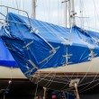Boat patched together for winter storage — Stok fotoğraf