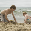 Young boys digging in the sand — Stock Photo #30767823