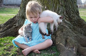 Blond little girl with armful of kittens — Stock Photo