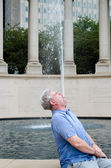 Man becomes a city fountain — Stock Photo