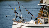 Charter fishing boat with fishing poles — Stock Photo