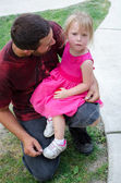 Daddy and sad little girl after a fall — Stock Photo