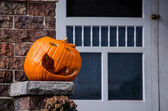 Jack o lantern on a brick porch — Stock Photo