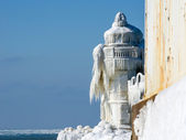 Ice decorated light house — Stock Photo