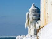Ice decorated light house — Stock Photo