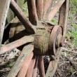 Stock Photo: Rough and old wagon wheel