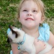 Hopeful child with cute kitten — Stock Photo
