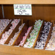 Salt water taffy in bins — Stock Photo