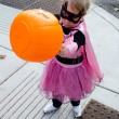 Little girl in halloween costume: where is the candy? — Stock Photo