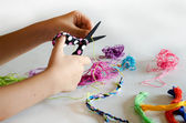 Making friendship bracelets — Stock Photo