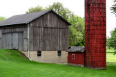 Old run down Michigan barn and silo — Stock Photo