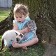 Girl and pet kittens — Stock Photo