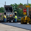 Постер, плакат: Repairing a road with hot asphalt