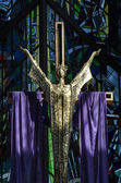 Modern crucifiz and jesus draped in purple for lent — Stock Photo
