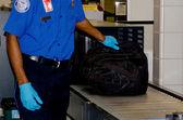 TSA handling a bag — Stock Photo