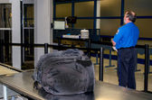 TSA and unattended  bag — Stock Photo