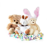 Stuffed buddies and candy eggs — Stock Photo