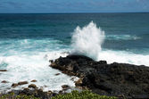 Waves and black lava rock — Stock Photo