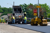 Repairing a road with hot asphalt — Stock Photo