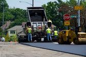 Dumping hot asphalt — Stock Photo