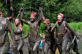 Happy girls in the mud — Stock Photo