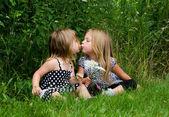 Sisters kissing — Stock Photo