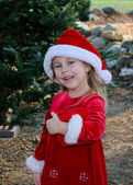 Cute girl in holiday red , holding a red wrapped box — Stock Photo