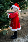 Disgruntled girl in holiday red — Stock Photo