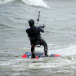 Kite boarder braces for a big wave — Stock Photo