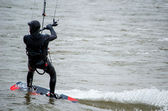 Kite boarder in winter wet suit — Stock Photo