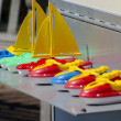 Toy sail boats in a row — Stock Photo #38229293