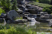 Sunlit waterfall — Stock Photo