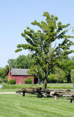 Rural  red barn with split rail fence — Stock Photo