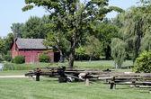 Rural farm with split rail fence — Stok fotoğraf