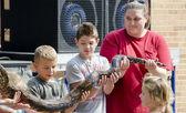 Kids hold a large snake — Stock Photo