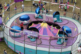 Tilt a whirl carnival ride — Stock Photo