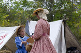 Mother and daughter dressed in 1800 period clothes — Photo