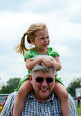 Girl on grandpas shoulders — Stok fotoğraf