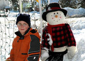 Little boy and snow man — Stock Photo