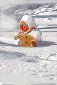 Christmas gingerbread man covered in snow — Stock Photo