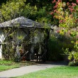 Rustic gazebo in the woods — Stock Photo #38236117
