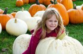 Little girl with large white pumpkin — Stock Photo
