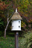 Fancy white bird house — Stock Photo