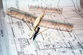Model airplane on plans — Stockfoto