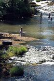 Children splash in the river — Stok fotoğraf