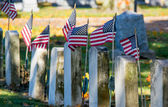 Old tomb stones with flags — Stock Photo