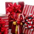 Holiday packages and candy cane on white — Stock Photo #39466907