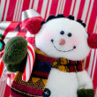 Snowman red and white background close up — Stock Photo