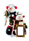 Two Snowean with blank picture frame, bird house, candy cane on white — Stock Photo