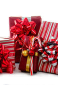 Holiday packages and candy cane on white — Stock Photo